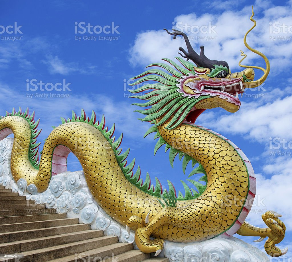 Giant chinese style dragon statue on blue sky background royalty-free stock photo