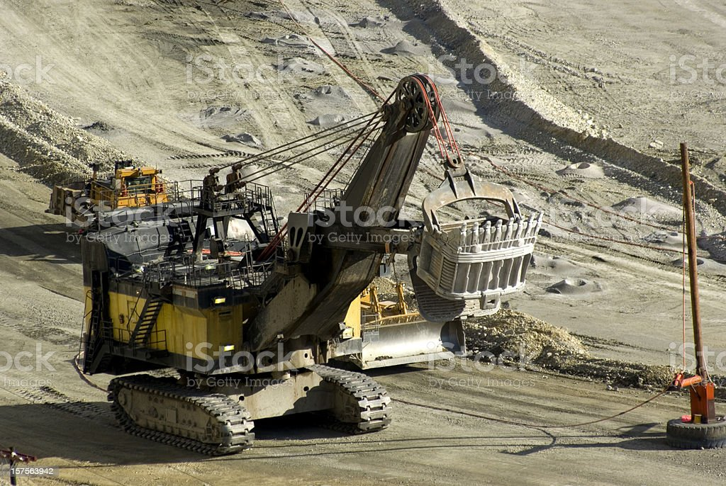 giant electric shovel in copper mine stock photo