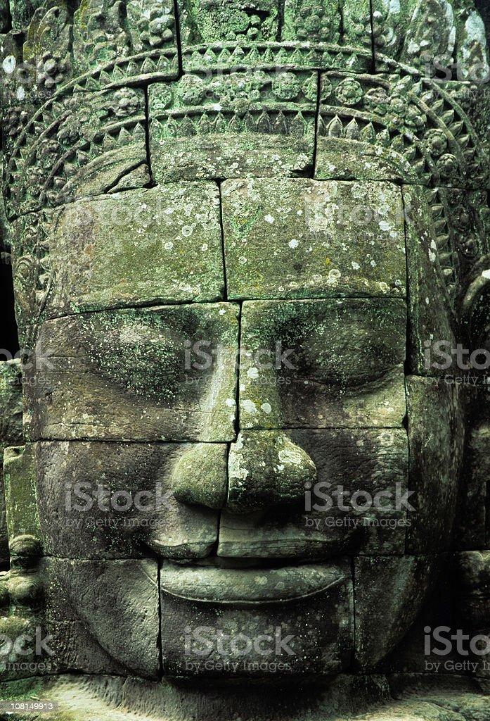 Giant face at Bayon Temple, Angkor Wat, Cambodia royalty-free stock photo