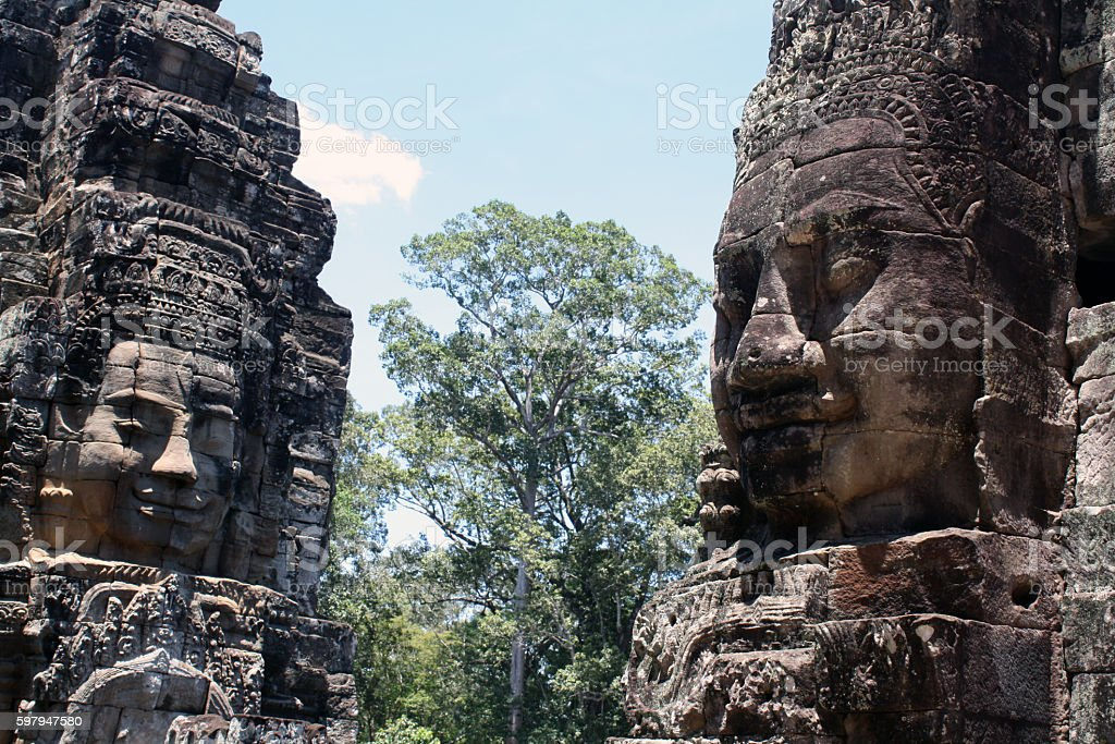 Giant faces of statues at Angkor Wat stock photo