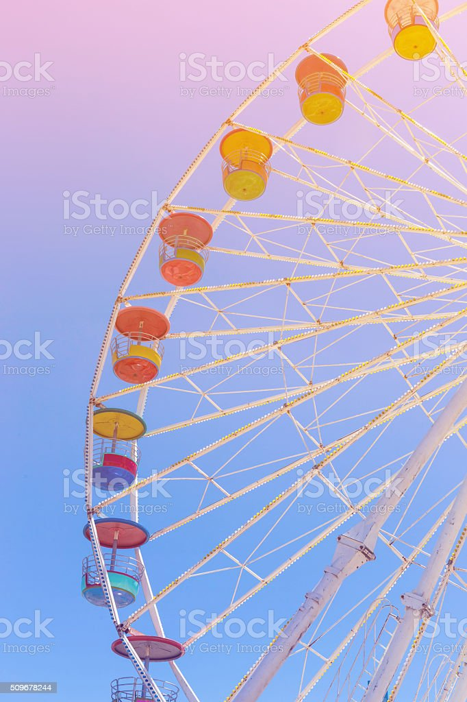 Giant ferris wheel in Amusement park with blue sky background stock photo