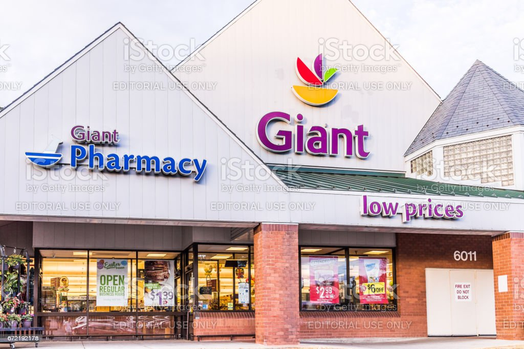 Giant food store sign and logo with building exterior facade stock photo