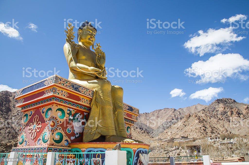 Giant golden sculpture of the Mitreya Buddha stock photo