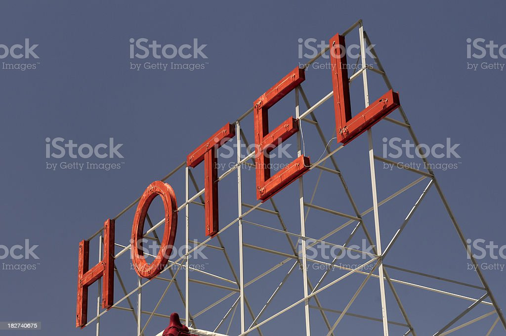 Giant Neon Rooftop Hotel Sign at Sunset royalty-free stock photo