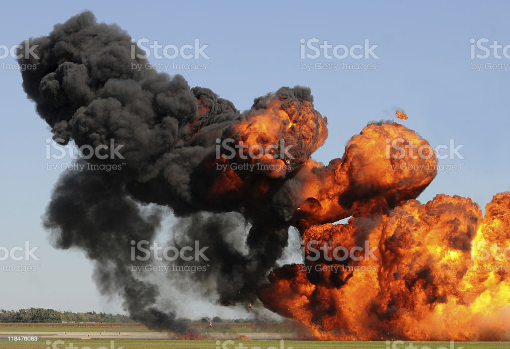 Giant orange, yellow, and black fire explosion royalty-free stock photo