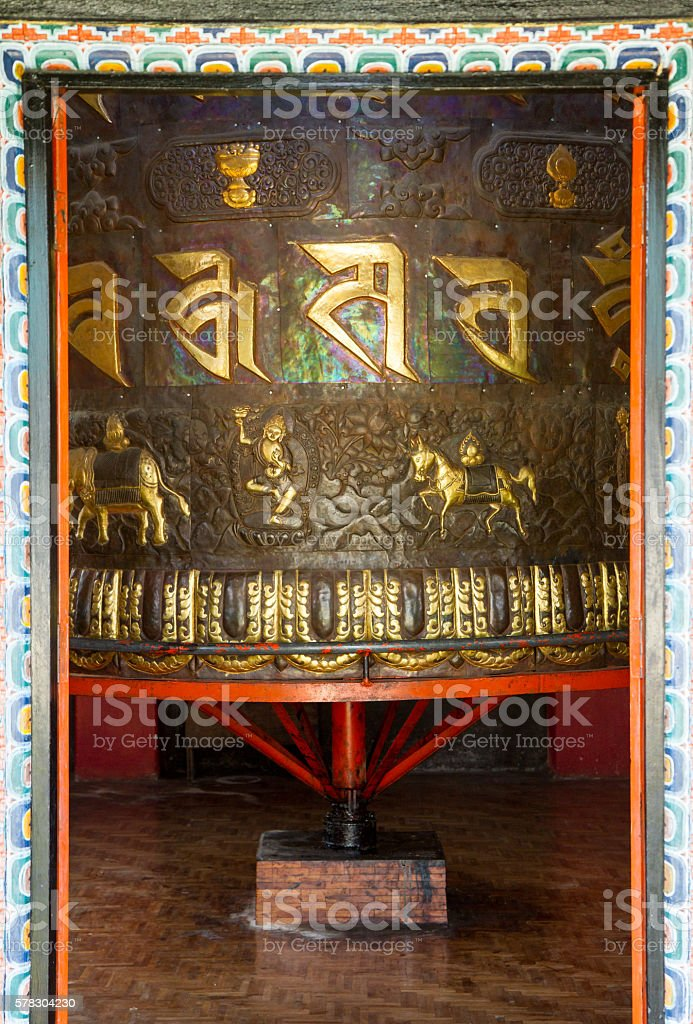 Giant ornate prayer wheel in a Buddhist monastery Tashiding stock photo