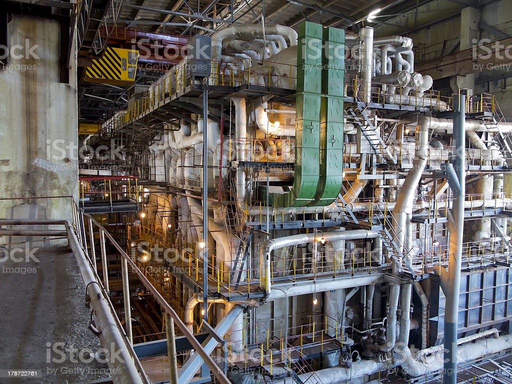 Giant pipes, tubes and equipment inside power plant, night scene royalty-free stock photo