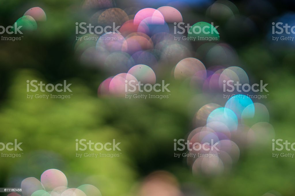 Giant rainbow soap bubbles floating in the summer air stock photo