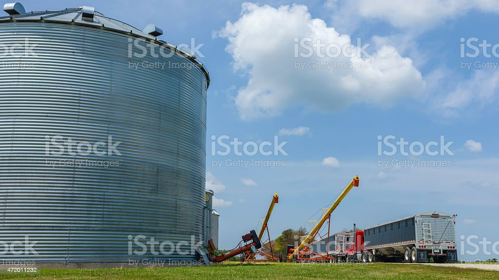 Giant silo, agricultural equipment, and HGV, Dover, Missouri, USA. stock photo