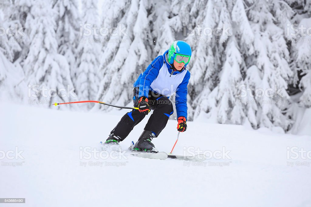 Giant slalom race  A young boy teenager  snow skier skiing stock photo