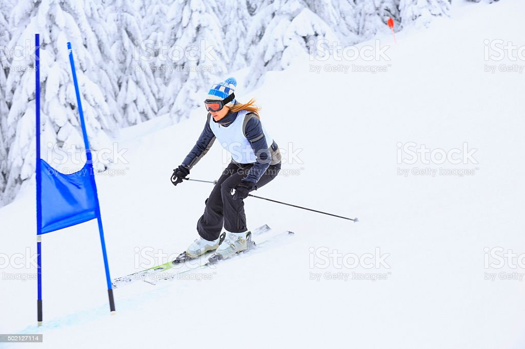 Giant slalom race. Women skier, snow skiing carving at high speed. A...