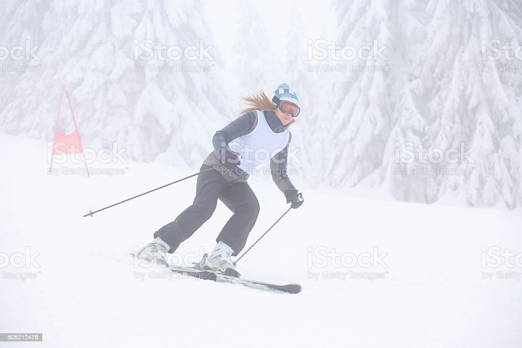 Giant slalom race  Women  snow skier skiing stock photo