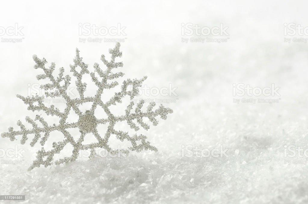 Giant snowflake on snow background royalty-free stock photo