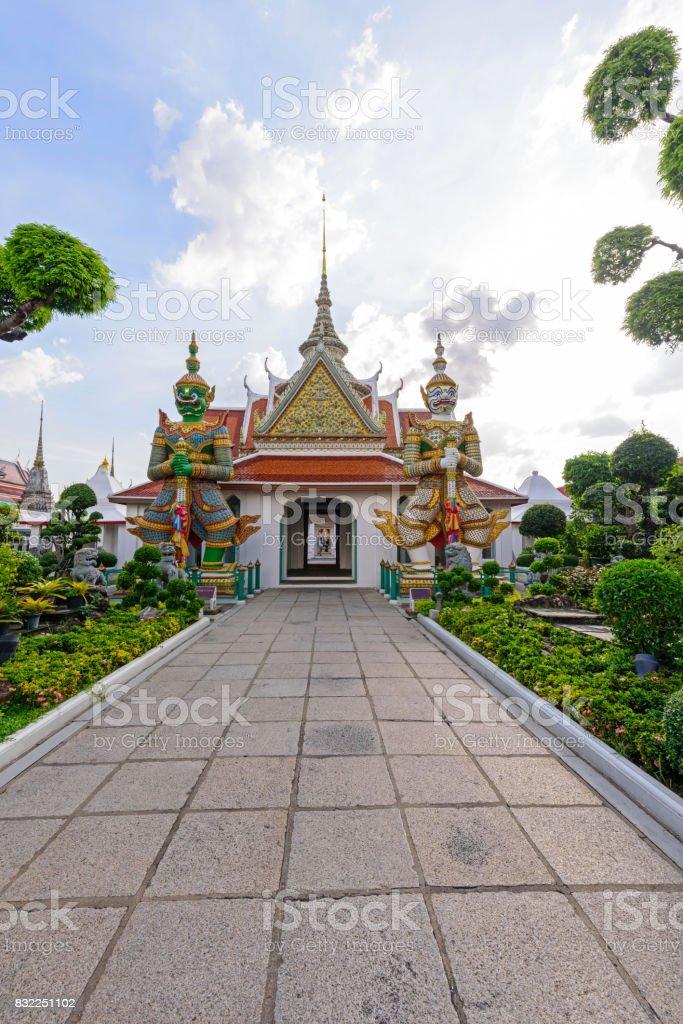 Giant statue in Wat Arun Ratchawararam Ratchawaramahawihan in Thailnd stock photo