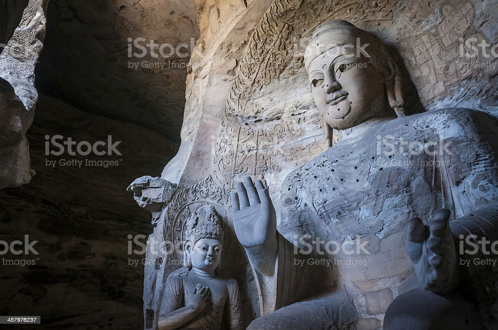 Giant stone Buddha in Yungang Grotto Shanxi China stock photo