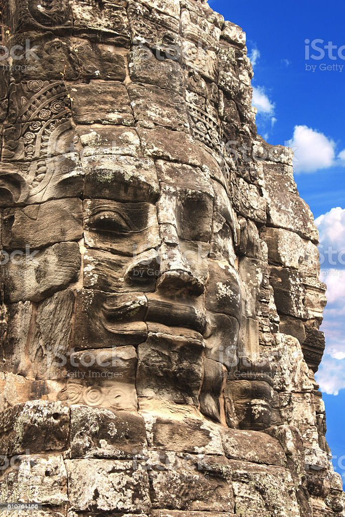 Giant stone face in Prasat Bayon Temple, Angkor Wat complex stock photo