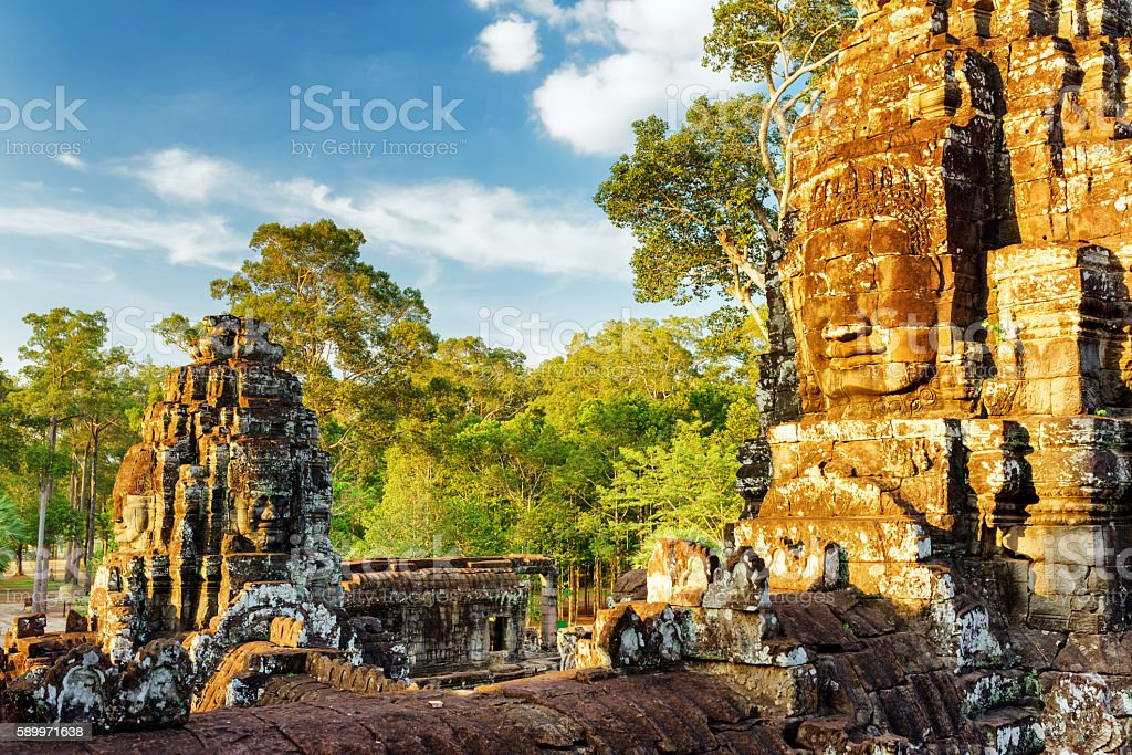 Giant stone face of Bayon temple in Angkor Thom, Cambodia stock photo