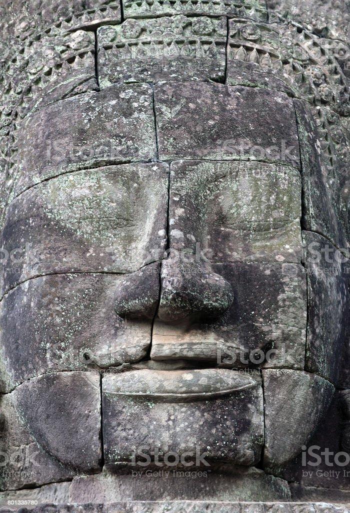 Giant stone faces at Prasat Bayon Temple, Cambodia stock photo