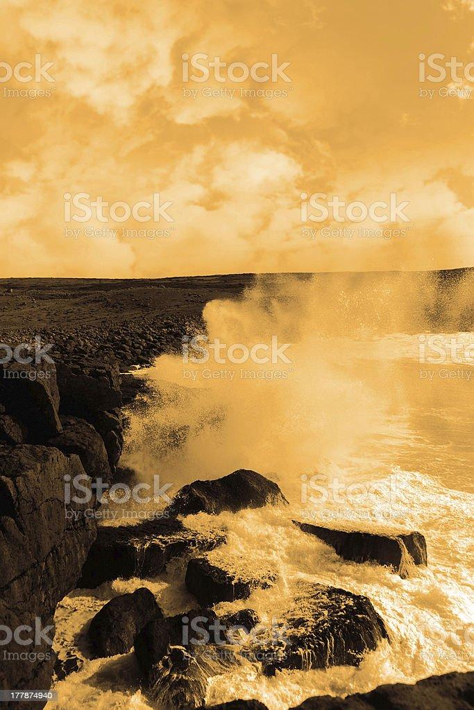 giant storm waves crashing on cliffs royalty-free stock photo