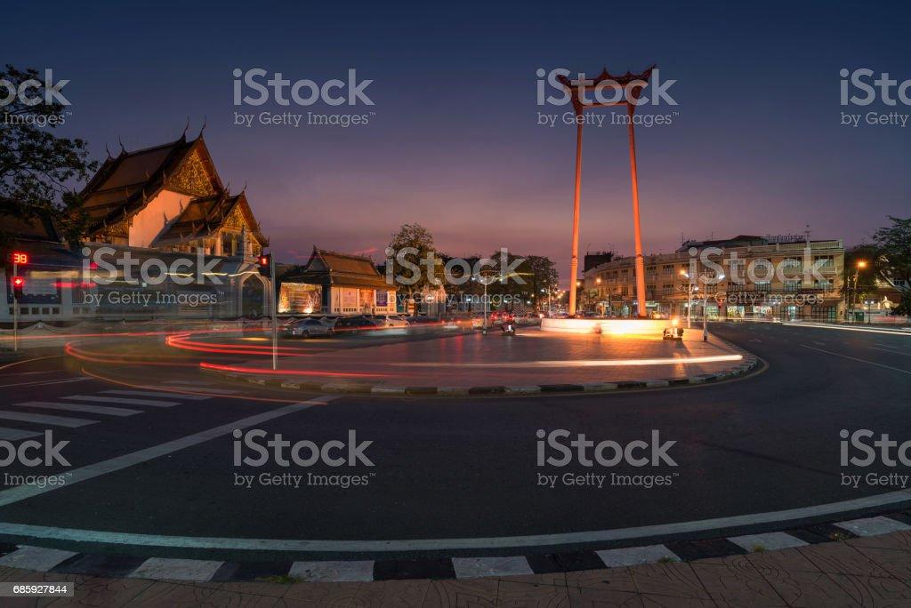 Giant Swing with Wat Suthat Thep Wararam in Bangkok, Thailand. stock photo