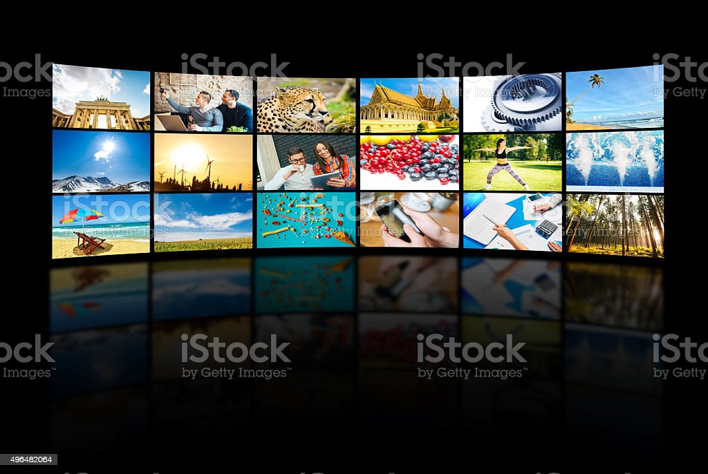 Giant TV screen and media concept with different TV channels stock photo