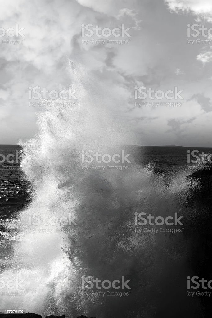 giant wave crashing on burren cliffs royalty-free stock photo