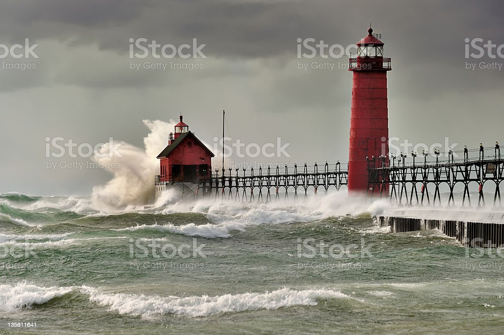 Giant waves over the red Grand Haven Lighthouse, Michigan royalty-free stock photo