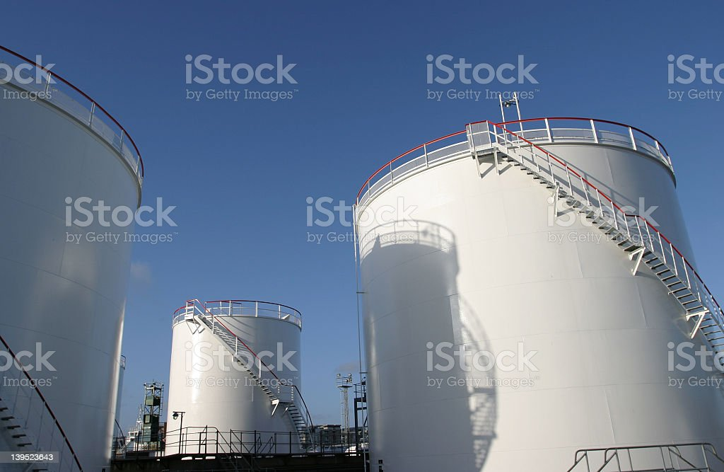 Giant white fuel tanks at industrial factory royalty-free stock photo