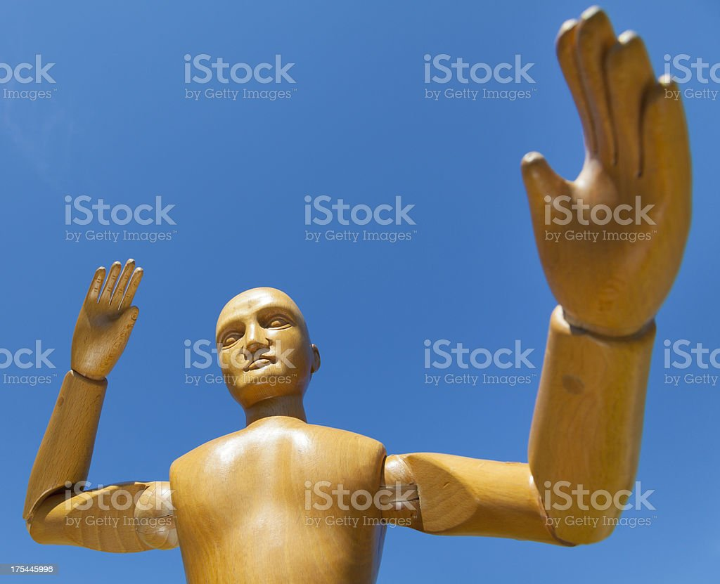 Giant Wooden Man Does Karate stock photo