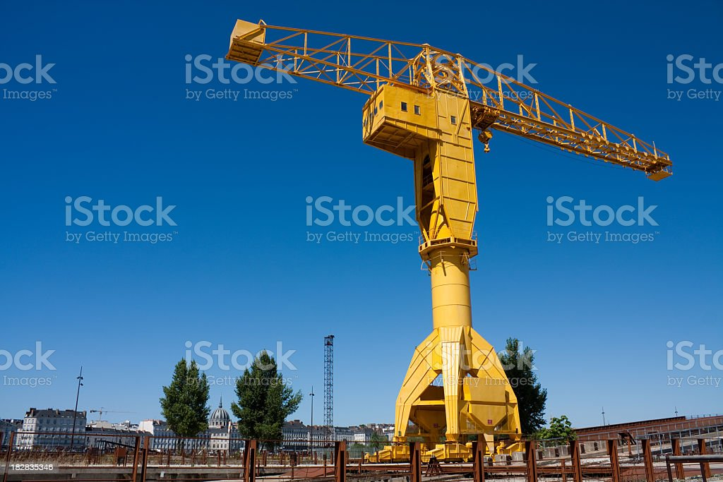Giant yellow crane towering over landscape stock photo