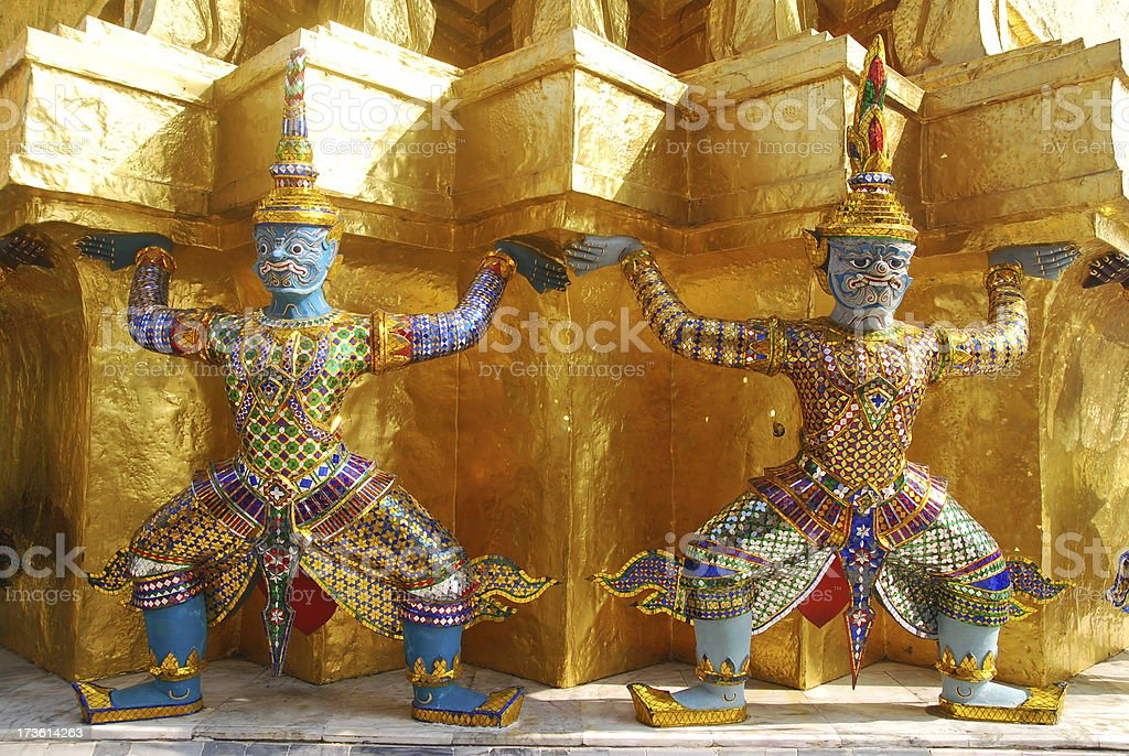 Giants around  Gold Pagoda royalty-free stock photo