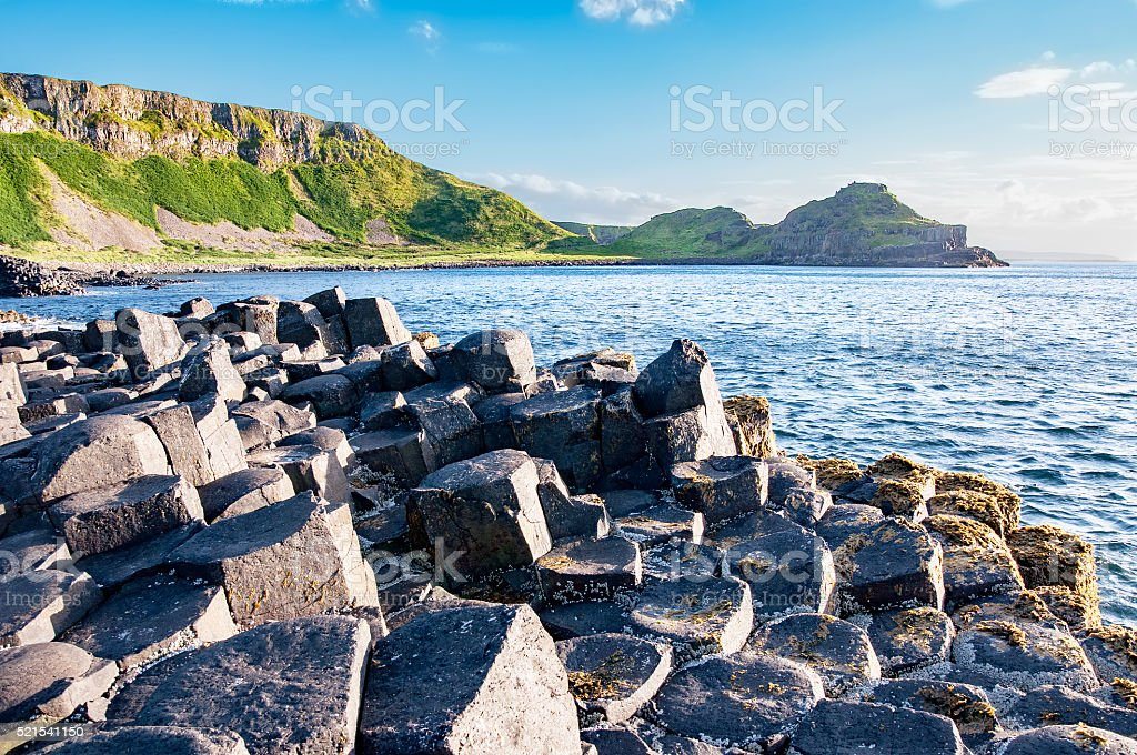 Giants Causeway and cliffs in Northern Ireland stock photo