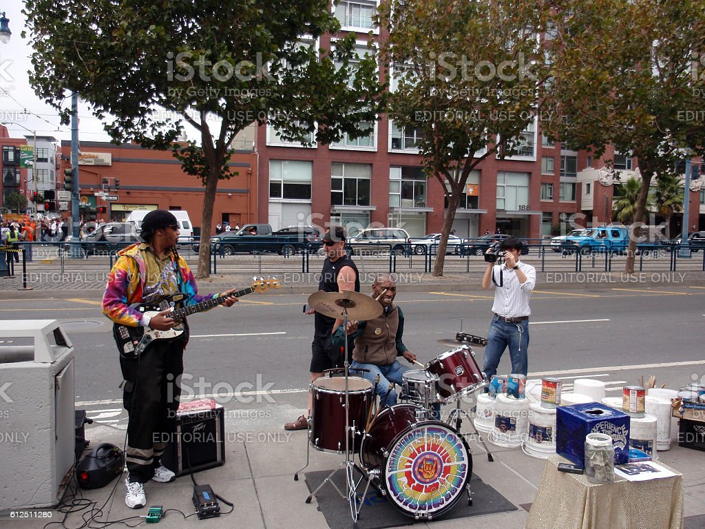 Giants fans play music outside stadium stock photo
