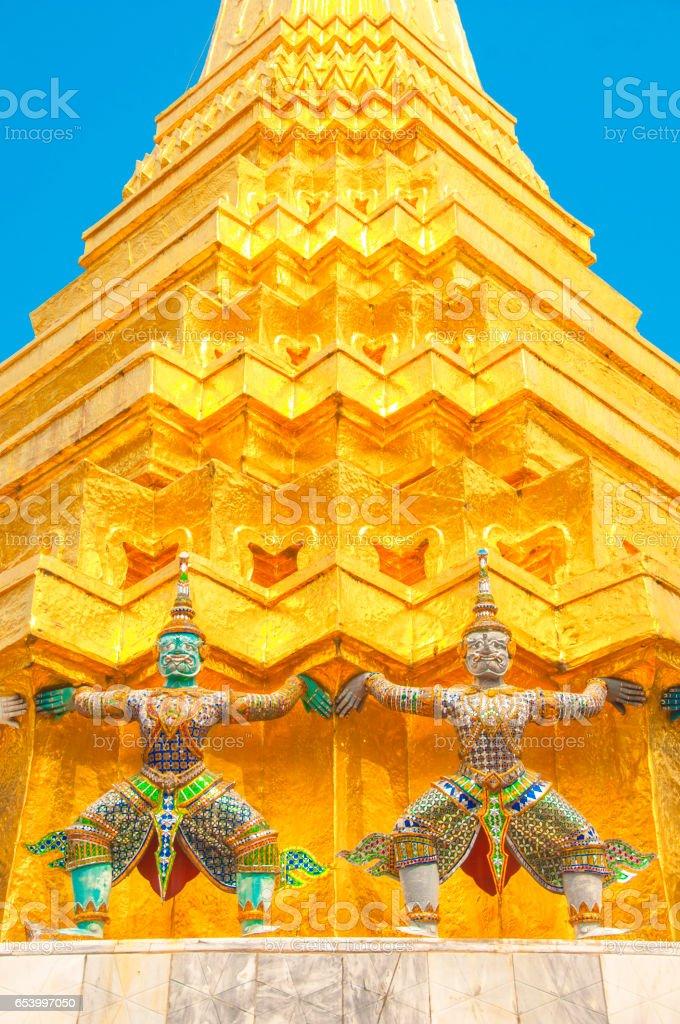 Giants under golden pagoda, Warrior statue at The Grand Palace and the temple Wat Phra Kaeo. Bangkok. Thailand. stock photo