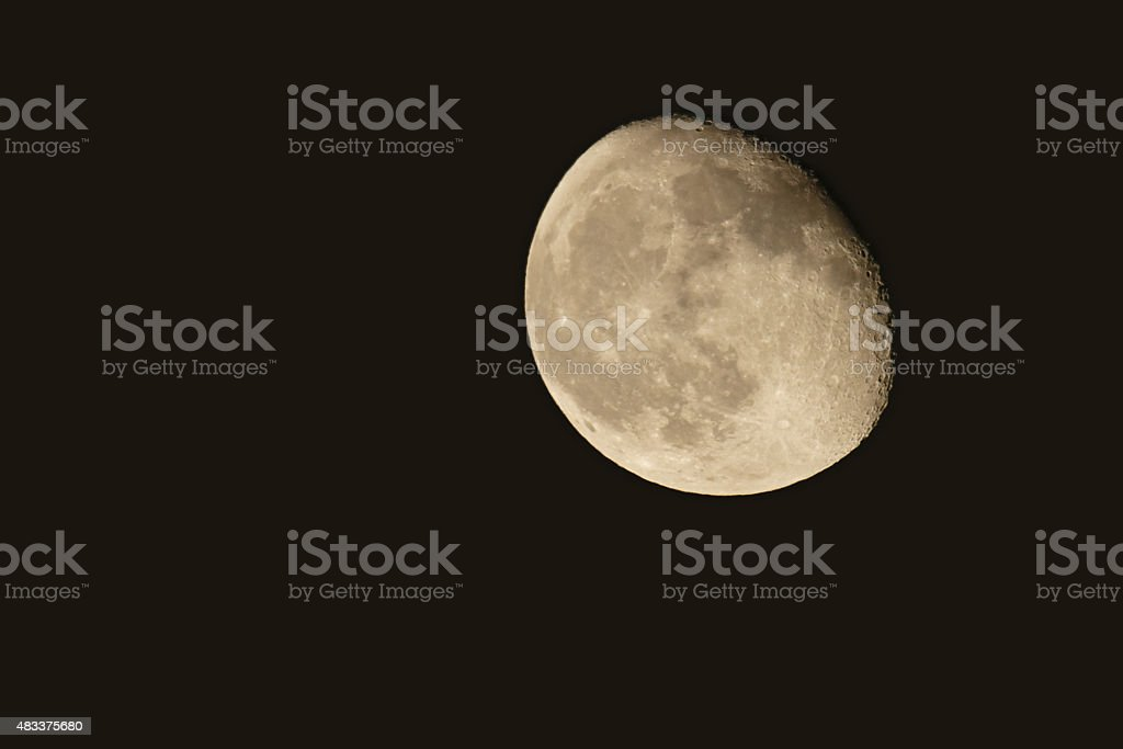 Gibbous moon against night sky stock photo