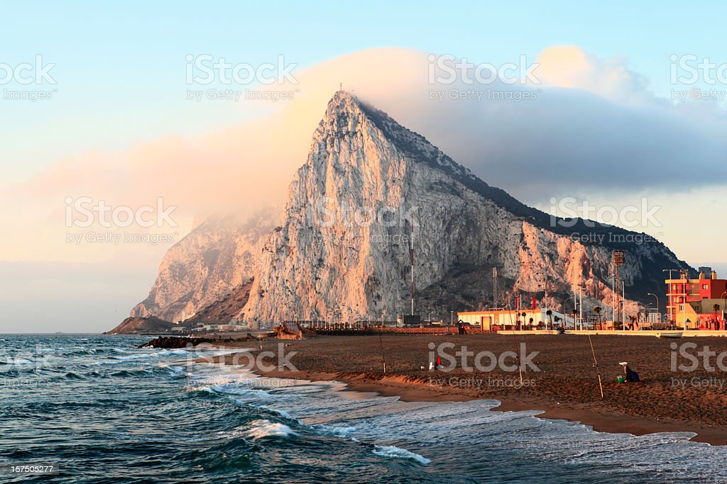 Gibraltar at sunrise with clouds on top stock photo