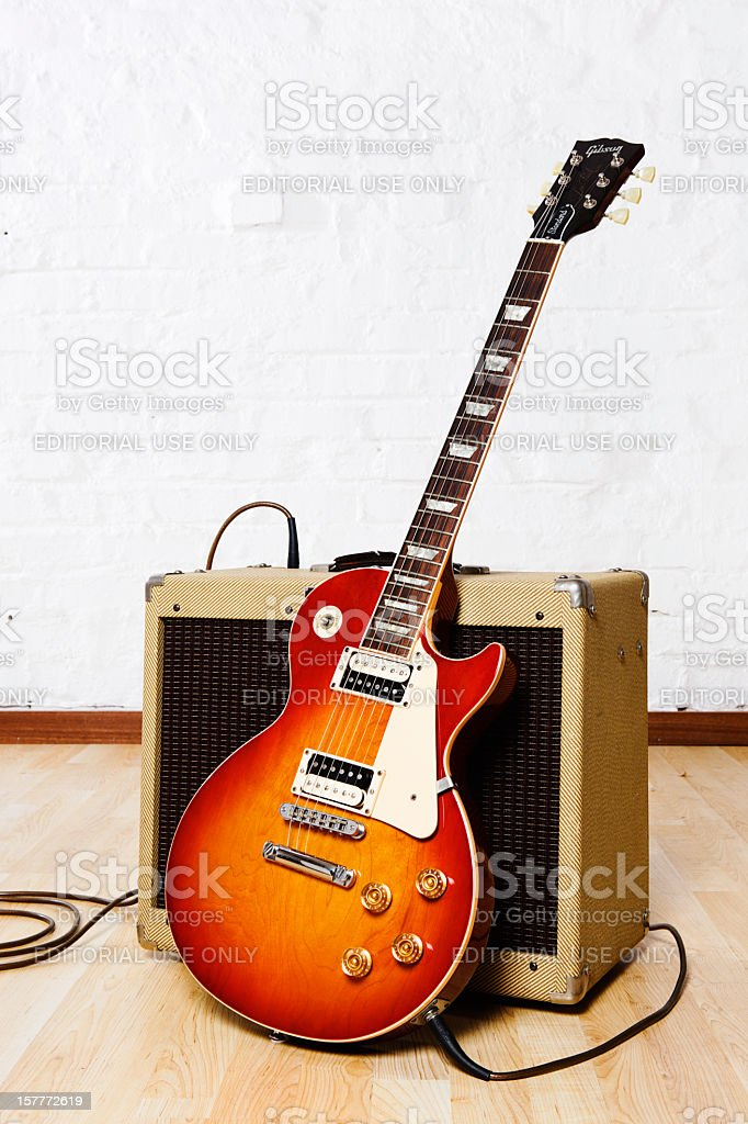 Gibson Les Paul electric guitar with retro-styled amplifier stock photo