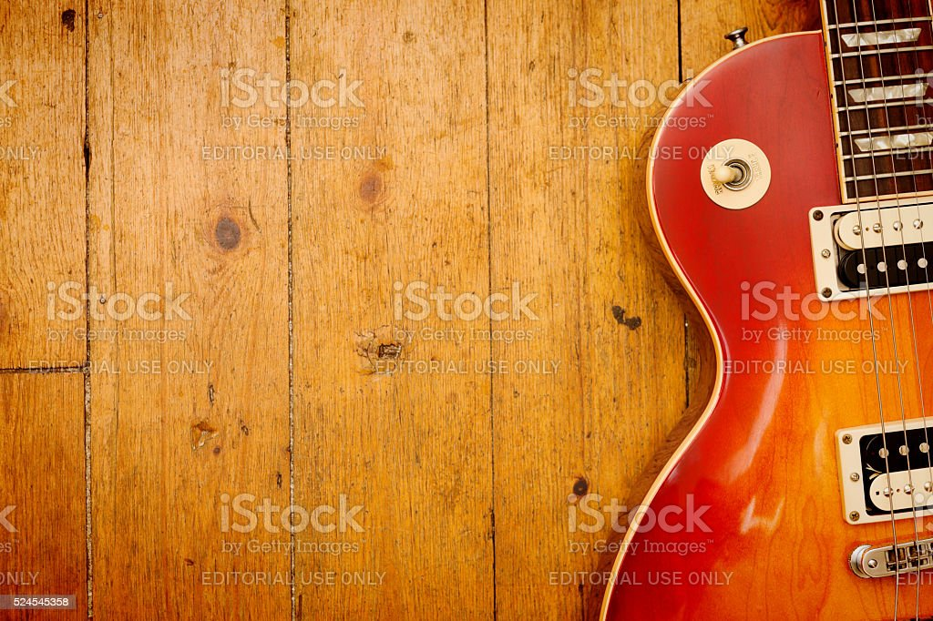 Gibson Les Paul Standard electric guitar on wood stock photo