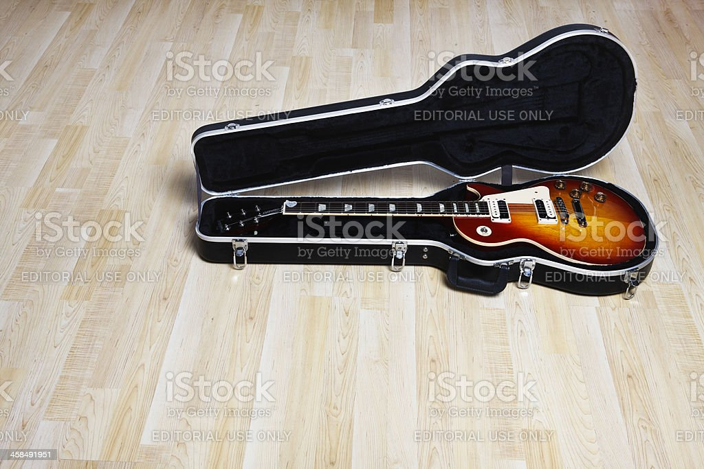 Gibson Les Paul Standard guitar in case on floor stock photo