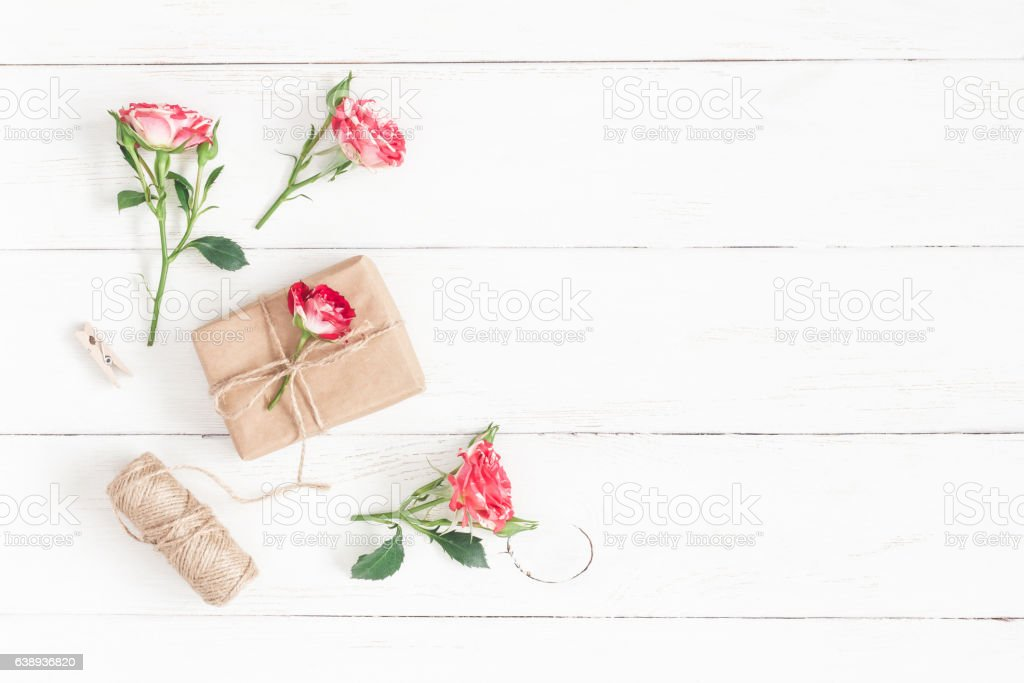 Gift and rose flowers. Flat lay, top view stock photo