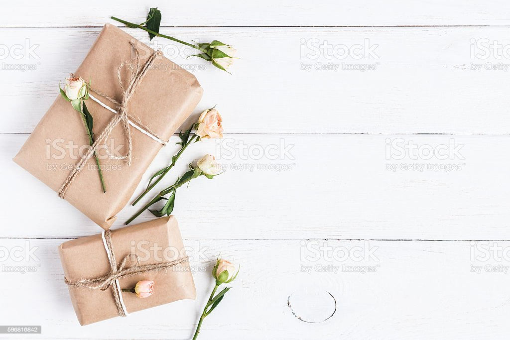 Gift and rose flowers. Top view, flat lay stock photo