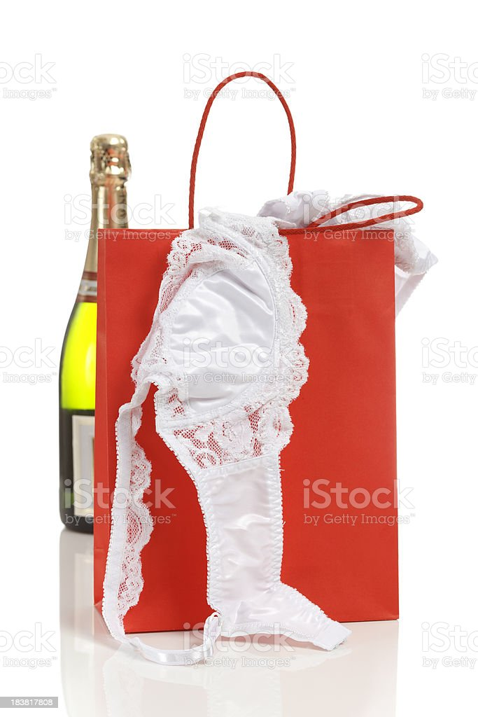 Gift bag with lingerie and champagne stock photo