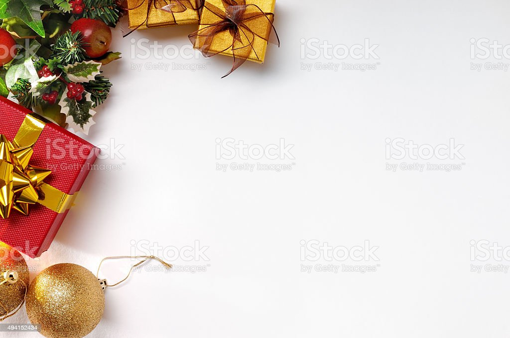 Gift ball and Christmas decoration to the left isolated top stock photo