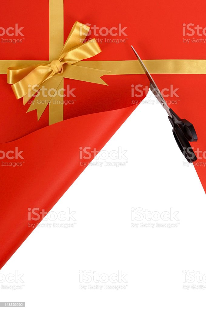Gift being cut open with scissors royalty-free stock photo
