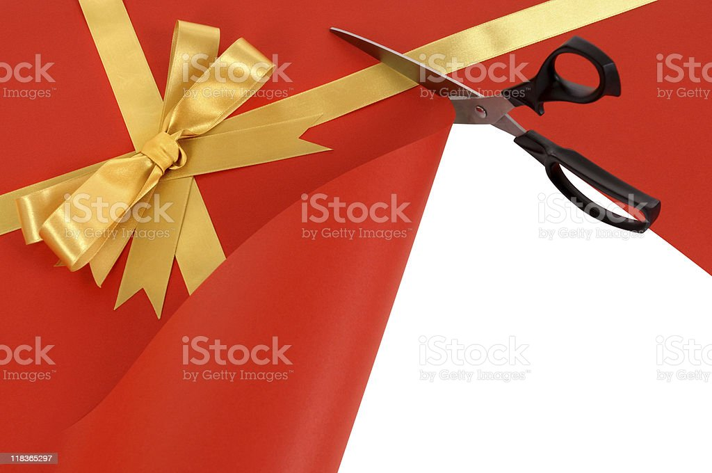 Gift being cut open with scissors stock photo