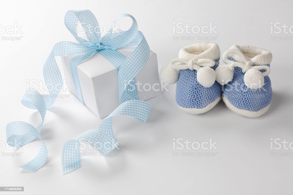 Gift box and baby boots. royalty-free stock photo