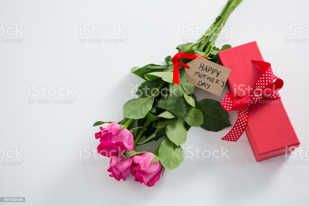 Gift box and bunch of pink rose with happy mothers day tag stock photo