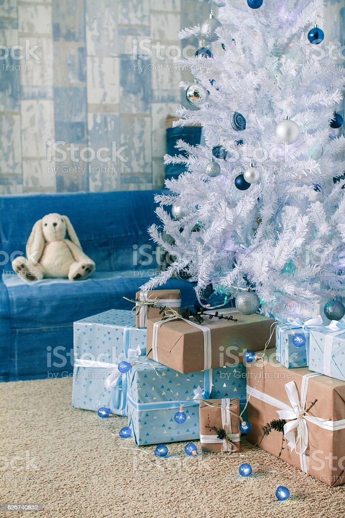 Gift box and Christmas tree decorations. stock photo