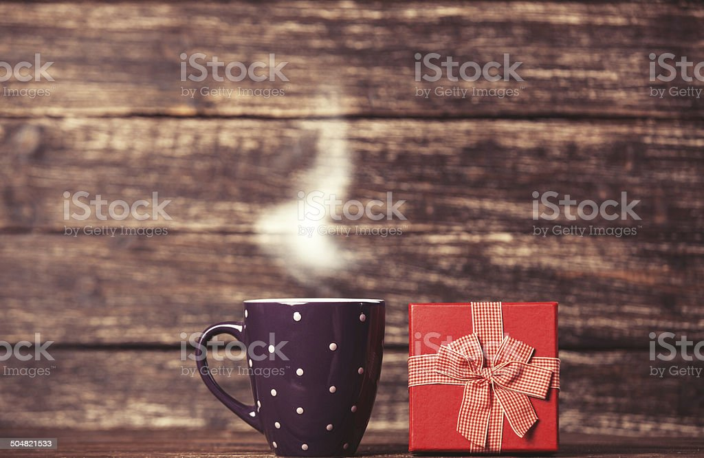 Gift box and cup of coffee stock photo