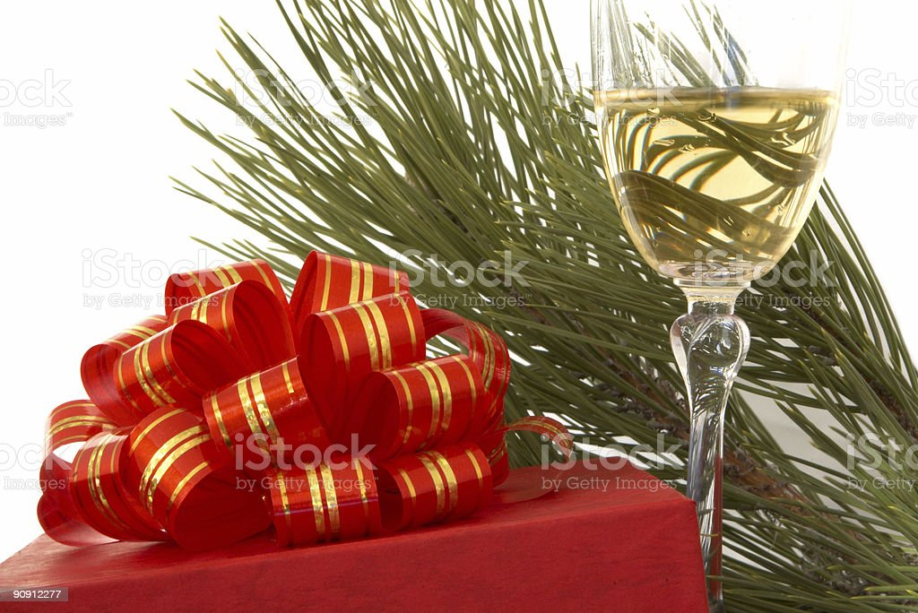 gift box and glass of champagne over white royalty-free stock photo
